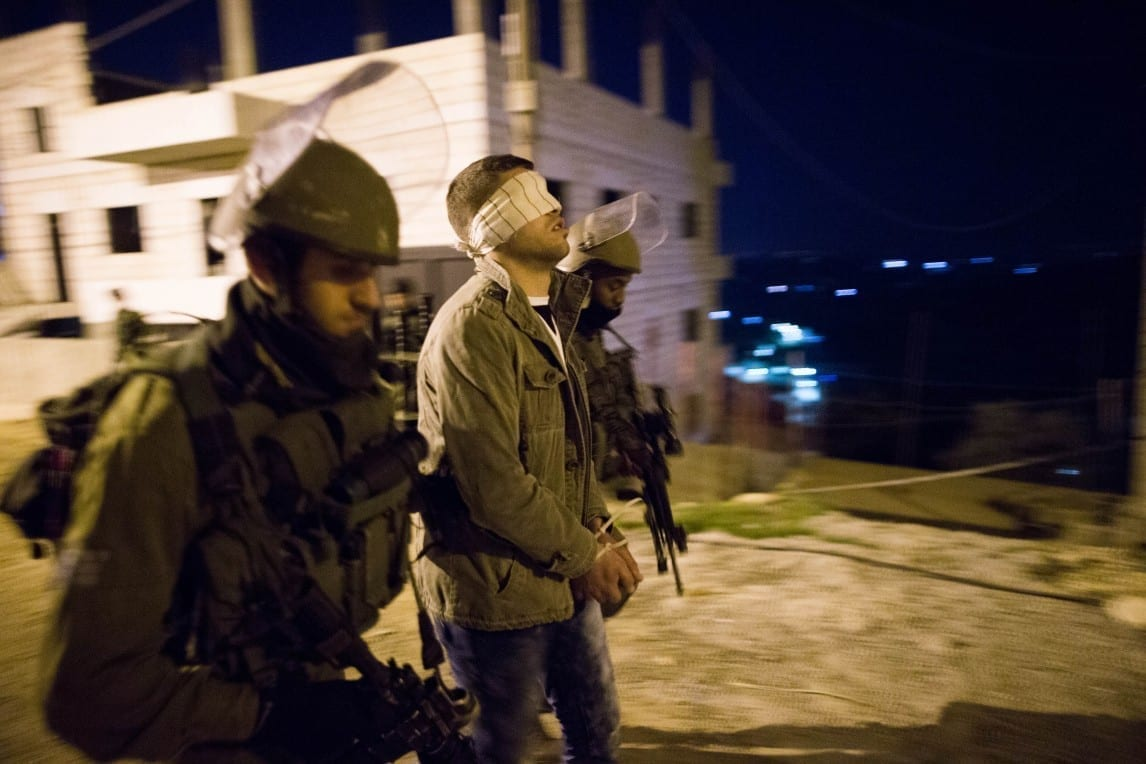 Photo of 14 Palestinians Arrested Across West Bank; Weapons and Bombs Seized