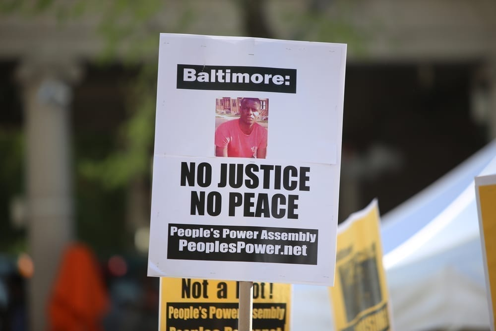 Photo of Police Try to Save Daughter of Baltimore Protester