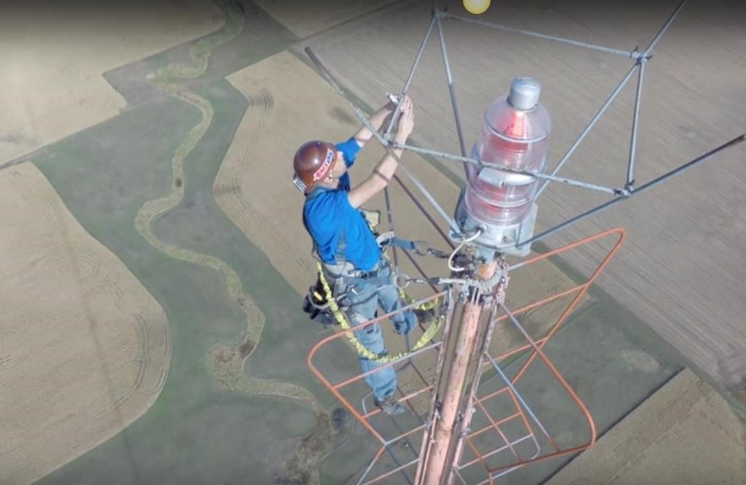 Photo of Changing a light bulb 1500 ft. Up in The Air
