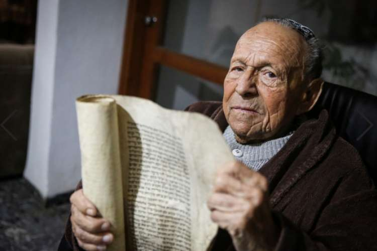 Photo of 100 Year Old Holocaust Survivor Presents: Megillat Esther Written by Rabbi Zusha of Anipoli